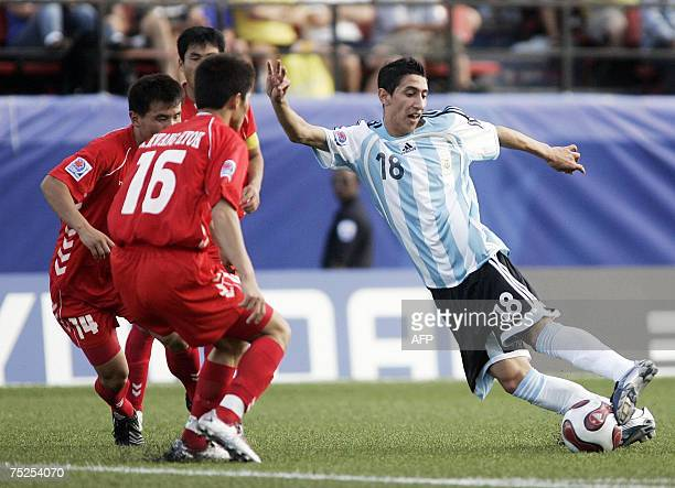 Argentina's Angel Di Maria handles the ball as North Korea's Kwang Hyok Ri during their match at the FIFA U20 World Cup on 06 July 2007 in Ottawa...
