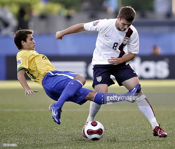 Brazil's Leandro Lima fights for the ball with USA's Robbie Rogers during their match at the FIFA U20 World Cup on 06 July 2007 in Ottawa Ontario...