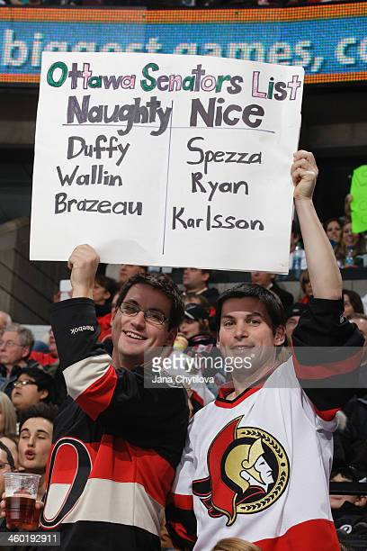 Ottawa fans hold up a Christmasthemed sign featuring naughty and nice list during an NHL game between the Pittsburgh Penguins and the Ottawa Senators...