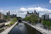 Ottawa Ontario Canada, in early spring. Parliament Hill the Chateau Laurier Hotel and the Rideau Canal a UNESCO world heritage site are visible.
