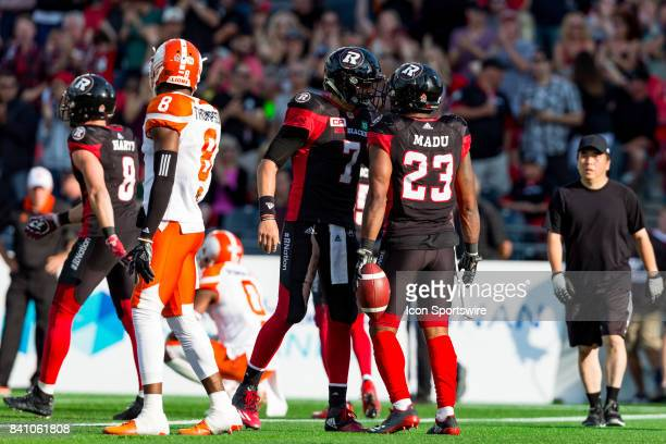 Ottawa RedBlacks quarterback Trevor Harris and running back Mossis Madu Jr celebrate a touchdown together during Canadian Football League action...