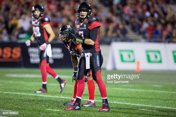 Ottawa RedBlacks quarterback Trevor Harris calls the play during Canadian Football League action between Edmonton Eskimos and Ottawa RedBlacks on...