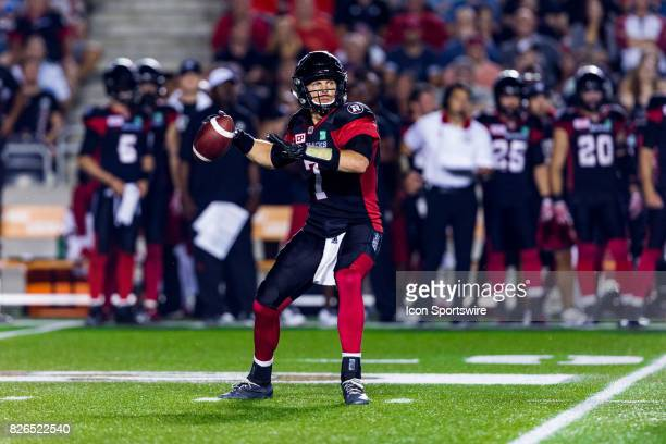 Ottawa RedBlacks quarterback Trevor Harris loads up to throw a pass downfield during Canadian Football League action between Montreal Alouettes and...