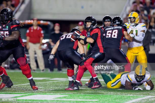 Ottawa RedBlacks quarterback Trevor Harris looks for an open receiver during Canadian Football League action between Edmonton Eskimos and Ottawa...