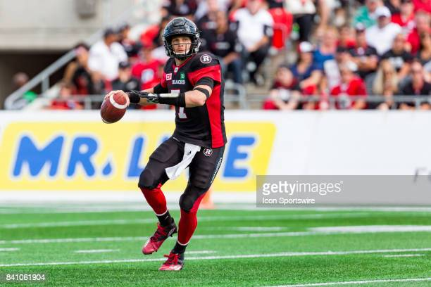 Ottawa RedBlacks quarterback Trevor Harris looks for an open receiver during Canadian Football League action between BC Lions and Ottawa RedBlacks on...