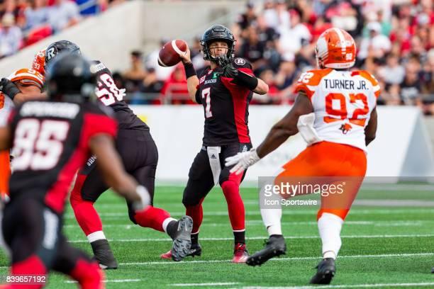 Ottawa RedBlacks quarterback Trevor Harris prepares to make a pass during Canadian Football League action between BC Lions and Ottawa RedBlacks on...