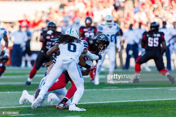 Ottawa RedBlacks wide receiver Brad Sinopoli is tackled by Toronto Argonauts defensive back Johnny Sears Jr during Canadian Football League action...