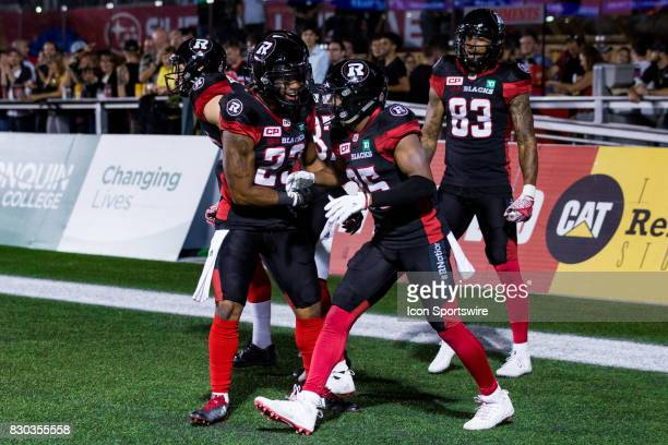 Ottawa RedBlacks wide receiver Diontae Spencer celebrates his touchdown with teammate running back Mossis Madu Jr during Canadian Football League...