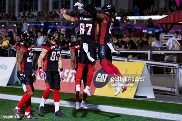 Ottawa RedBlacks wide receiver Diontae Spencer celebrates his touchdown with teammate wide receiver Joshua Stangby during Canadian Football League...