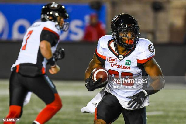 Ottawa Redblacks wide receiver Dominique Rhymes running with the ball after Ottawa Redblacks quarterback Trevor Harris handed it to him during the...
