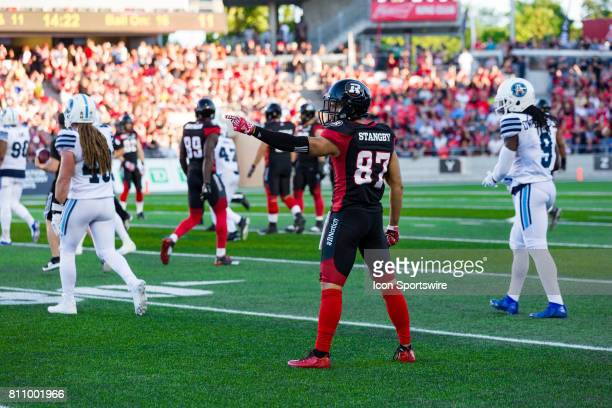 Ottawa RedBlacks wide receiver Joshua Stangby points for the first down after making a catch during Canadian Football League action between the...