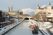 Ottawa Rideau Canal Skateway in winter with Parliament Hill and Chateau Laurier in the background
