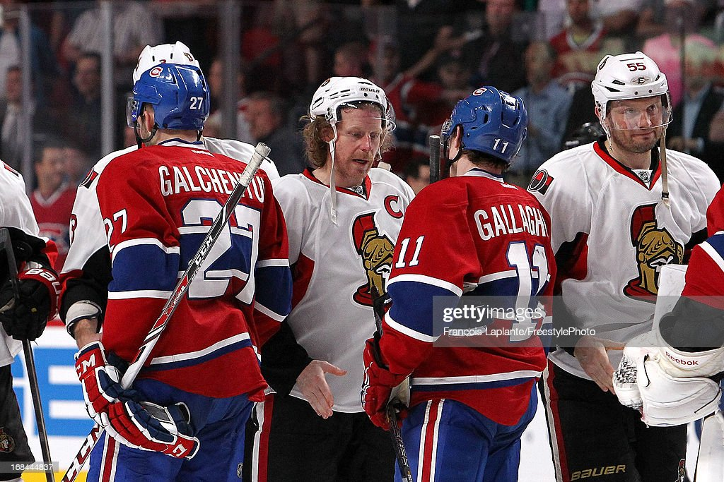 Ottawa Senators captain <a gi-track='captionPersonalityLinkClicked' href=/galleries/search?phrase=Daniel+Alfredsson&family=editorial&specificpeople=201853 ng-click='$event.stopPropagation()'>Daniel Alfredsson</a> #11 exchange a hand shake with Alex Galchenyuk #27 of the Montreal Canadiens and <a gi-track='captionPersonalityLinkClicked' href=/galleries/search?phrase=Brendan+Gallagher&family=editorial&specificpeople=3704208 ng-click='$event.stopPropagation()'>Brendan Gallagher</a> #11 after wining their first serie in Game Five of the Eastern Conference Quarterfinals during the 2013 NHL Stanley Cup Playoffs at the Bell Centre on May 9, 2013 in Montreal, Quebec, Canada.