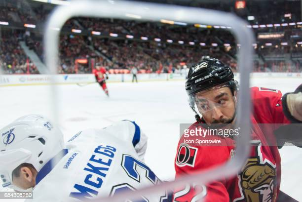 Ottawa Senators Center Chris Kelly battles with Tampa Bay Lightning Left Wing Greg McKegg against the boards during the NHL game between the Ottawa...