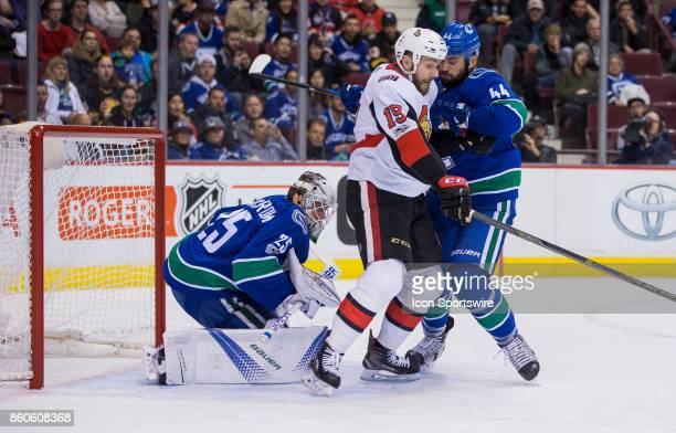 Ottawa Senators Center Derick Brassard battles with Vancouver Canucks Defenceman Erik Gudbranson in front of Vancouver Canucks Goalie Jacob Markstrom...