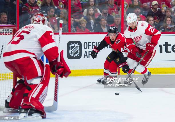 Ottawa Senators Center JeanGabriel Pageau and Detroit Red Wings Defenceman Mike Green battle for the puck as Detroit Red Wings Goalie Jimmy Howard...
