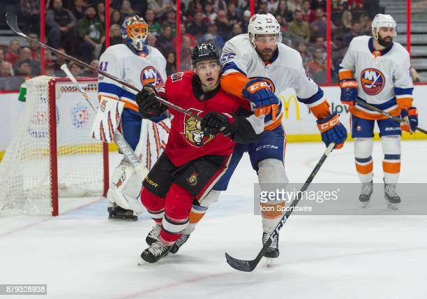 Ottawa Senators Center JeanGabriel Pageau and New York Islanders Defenceman Johnny Boychuk battle for position during the third period of the NHL...