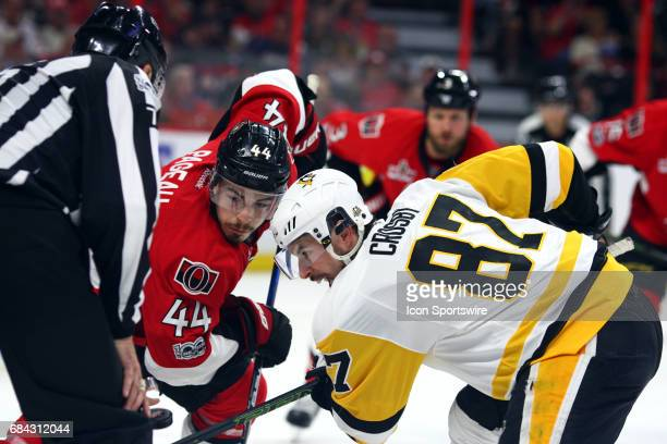 Ottawa Senators Center JeanGabriel Pageau and Pittsburgh Penguins Center Sidney Crosby face off in the second period of Game 3 of the Eastern...
