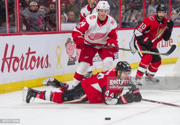 Ottawa Senators Center JeanGabriel Pageau crashes to the ice under pressure from Detroit Red Wings Right Wing Gustav Nyquist in the third period of...