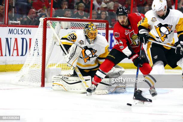 Ottawa Senators Center JeanGabriel Pageau looks for a tip in front of Pittsburgh Penguins Goalie MarcAndre Fleury during the first period of Game 3...
