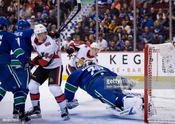 Ottawa Senators Center JeanGabriel Pageau looks on as Center Derick Brassard scores on Vancouver Canucks Goalie Jacob Markstrom in the third period...