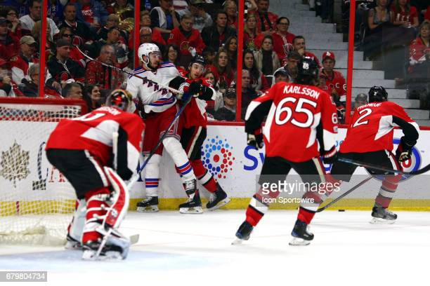 Ottawa Senators Center Kyle Turris and New York Rangers Center Mika Zibanejad run into each other as the watch the puck get picked up in the third...