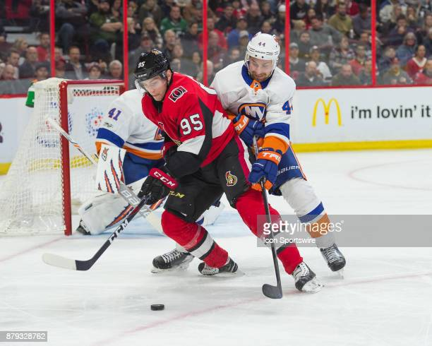 Ottawa Senators Center Matt Duchene and New York Islanders Defenceman Calvin De Haan battle for the puck during the third period of the NHL game...