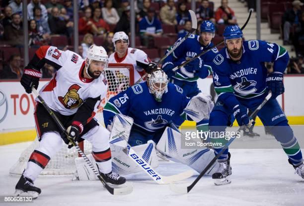 Ottawa Senators Center Nate Thompson and Vancouver Canucks Goalie Jacob Markstrom and Defenceman Erik Gudbranson wait for shot during a NHL hockey...
