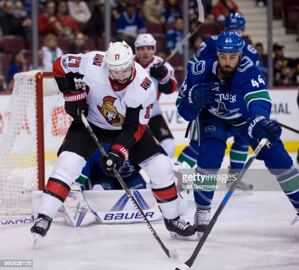 Ottawa Senators Center Nate Thompson battles with Vancouver Canucks Defenceman Erik Gudbranson during a NHL hockey game on October 10 at Rogers Arena...