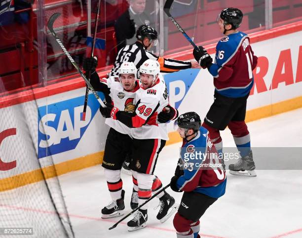 Ottawa Senators Christopher DiDomenico celebrates with JeanGabriel Pageau his goal in the second period of the NHL Global Series hockey game between...