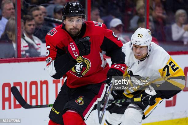 Ottawa Senators Defenceman Cody Ceci chases the puck with Pittsburgh Penguins Right Wing Patric Hornqvist in tow during third period National Hockey...