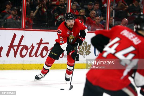 Ottawa Senators Defenceman Cody Ceci moves the puck to Ottawa Senators Center JeanGabriel Pageau in the third period of Game 3 of the Eastern...