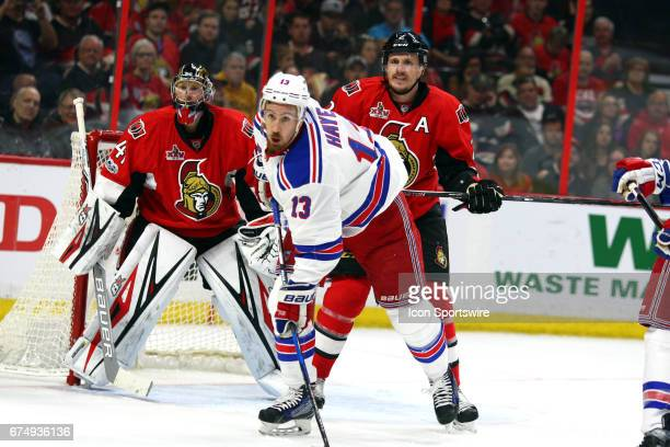 Ottawa Senators Defenceman Dion Phaneuf cross checks New York Rangers Center Kevin Hayes in front of Ottawa Senators Goalie Craig Anderson during the...