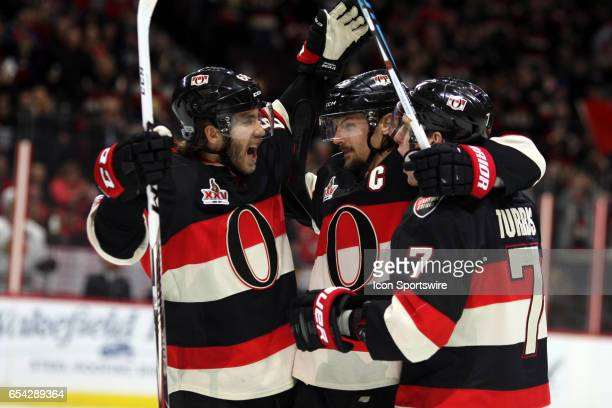 Ottawa Senators Defenceman Erik Karlsson celebrates a goal with Ottawa Senators Center Kyle Turris and Ottawa Senators Left Wing Mike Hoffman in the...