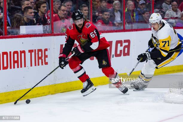Ottawa Senators Defenceman Erik Karlsson plays the puck out from behind the net as Pittsburgh Penguins Center Evgeni Malkin gives chase during second...