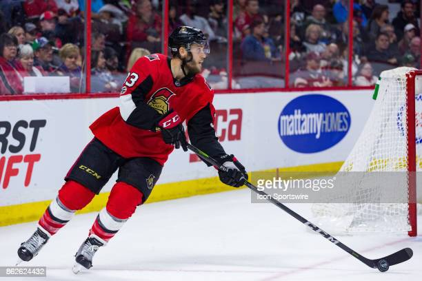 Ottawa Senators Defenceman Fredrik Claesson skates the puck out from behind his own net during third period National Hockey League action between the...