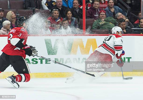 Ottawa Senators Defenceman Marc Methot gets a snow shower from Carolina Hurricanes Winger Sebastian Aho during the NHL game between the Ottawa...