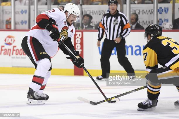 Ottawa Senators defenseman Dion Phaneuf shoots the puck in front of Pittsburgh Penguins Center Carter Rowney during the first period in Game Five of...