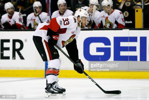Ottawa Senators defenseman Fredrik Claesson gets set for an offensive zone face off during a regular season NHL game between the Boston Bruins and...