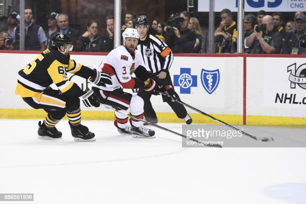 Ottawa Senators defenseman Marc Methot skates with the puck around Pittsburgh Penguins Defenseman Ron Hainsey during the first period in Game Five of...