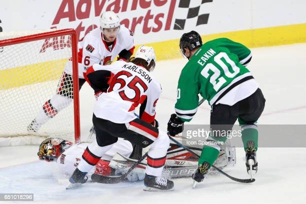 Ottawa Senators Goalie Craig Anderson lies on top of the puck during the NHL hockey game between the Ottawa Senators and Dallas Stars on March 8 2017...