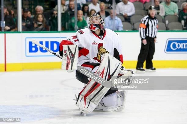 Ottawa Senators Goalie Craig Anderson looks up at a deflected puck during the NHL hockey game between the Ottawa Senators and Dallas Stars on March 8...
