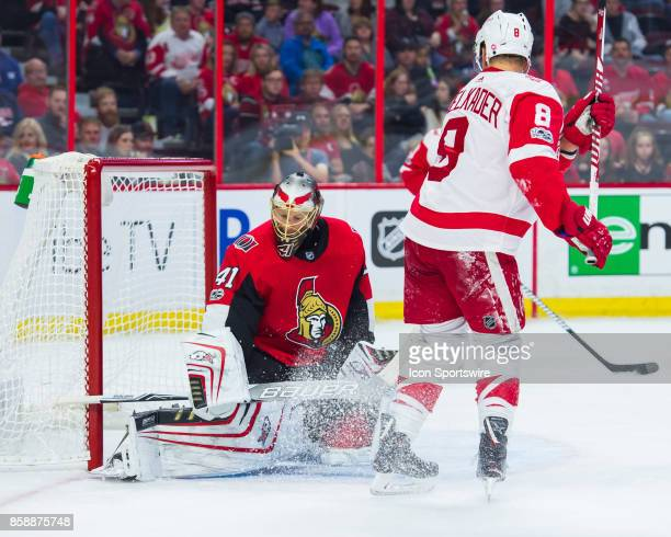 Ottawa Senators Goalie Craig Anderson makes a body save as Detroit Red Wings Right Wing Justin Abdelkader watches on during the NHL game between the...