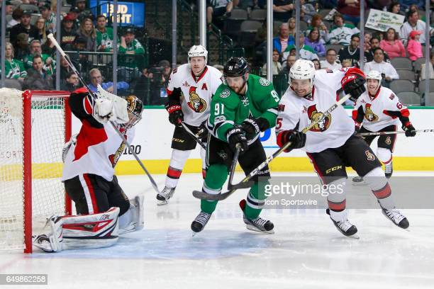 Ottawa Senators Goalie Craig Anderson makes a pad save with Dallas Stars Right Wing Tyler Seguin lurking in front during the NHL hockey game between...