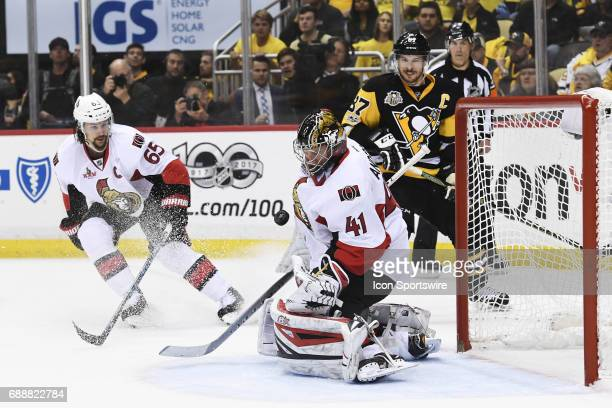 Ottawa Senators goalie Craig Anderson makes a save as Pittsburgh Penguins Center Sidney Crosby and Ottawa Senators defenseman Erik Karlsson react...
