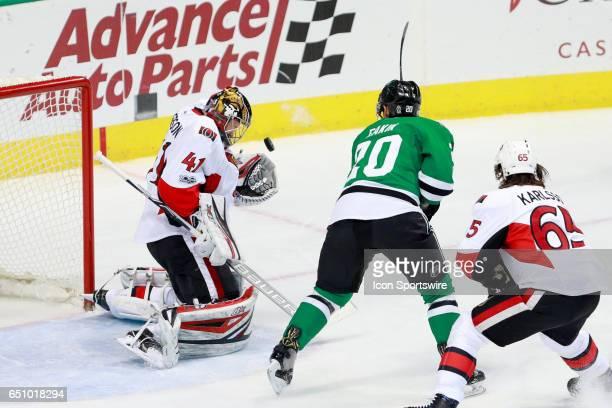 Ottawa Senators Goalie Craig Anderson takes a shot up high during the NHL hockey game between the Ottawa Senators and Dallas Stars on March 8 2017 at...