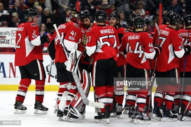 Ottawa Senators Goalie Craig Anderson with a head tap for Ottawa Senators Defenceman Cody Ceci as they celebrate with their team following a 31...