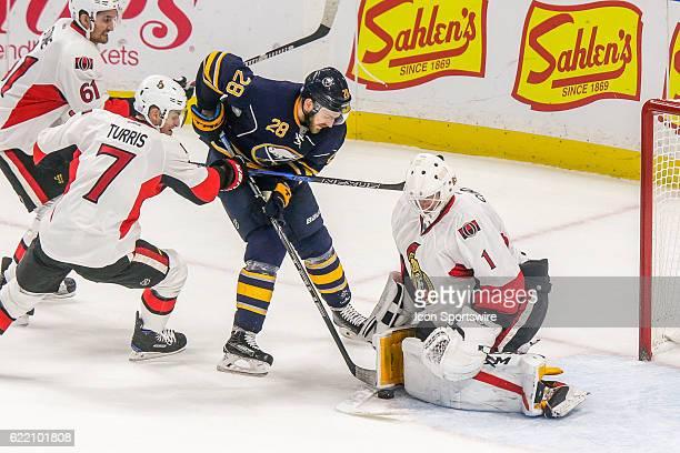 Ottawa Senators Goalie Mike Condon makes save on shot by Buffalo Sabres Center Zemgus Girgensons as Ottawa Senators Center Kyle Turris and Ottawa...