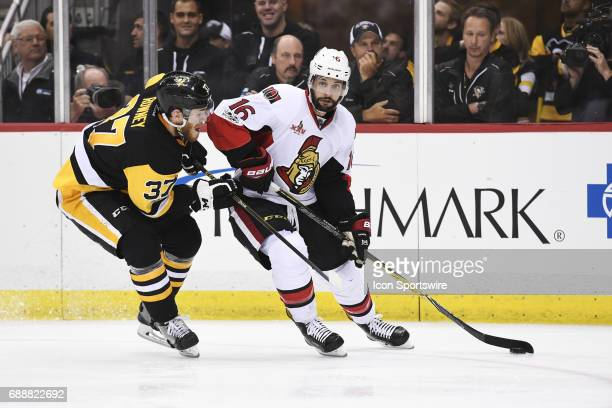 Ottawa Senators left wing Clarke MacArthur skates with the puck as Pittsburgh Penguins Center Carter Rowney defends during the third period The...