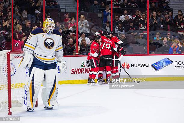 Ottawa Senators Left Wing Mike Hoffman celebrates his goal with teammates during second period National Hockey League action between the Buffalo...